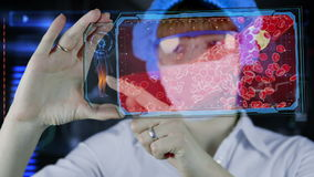 Doctor with futuristic hud screen tablet. Clogged Artery cholesterol plaque. Medical concept of the future