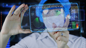 Doctor with futuristic hud screen tablet. Earth map and radar. the future stock photos