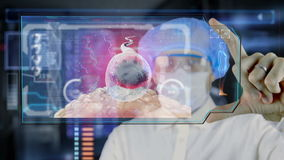 Doctor with futuristic hud screen tablet. Sperm, spermatozoons ovule to egg cell. Medical concept of the future.  stock video