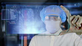 Doctor with futuristic hud screen tablet. Sperm, spermatozoons ovule to egg cell. Medical concept of the future.  stock footage