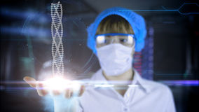 Doctor with futuristic tablet on hand.  DNA. Medical concept of the future. Stock Image