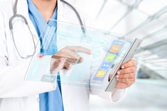 Doctor with futuristic tablet Stock Photography