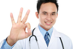 Doctor gesturing ok sign Stock Images