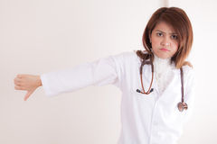 Doctor Gesturing Thumbs down Stock Photography