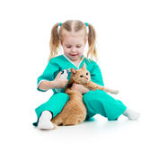 Doctor girl playing with cat Stock Photos