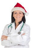 Doctor girl with with Santa Claus hat Stock Photo