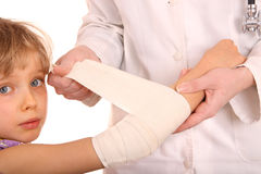 Doctor give first aid of child. Royalty Free Stock Photos