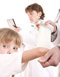 Doctor give first aid of child. Stock Photo