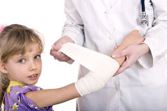 Doctor give first aid of child. Royalty Free Stock Photo