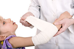 Doctor give first aid of child. royalty free stock photography
