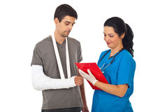 Doctor give prescription to injured man. Friendly doctor woman giving prescription to injured man and writing in clipboard isolated on white background royalty free stock photos