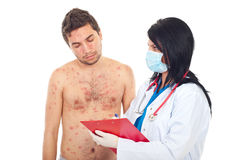 Doctor give prescription to sick man. Doctor woman with mask giving prescription to a sick patient man with chickenpox isolated on white background Stock Photography