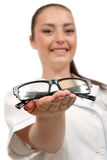 Doctor gives glasses Royalty Free Stock Photos