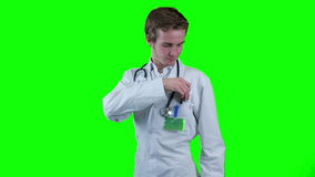 Doctor gives pills into camera. Thumbs up. Chromakey. Unrecognizable doctor's hand gives pills into camera. Thumbs up. Therapy, cure concept stock video