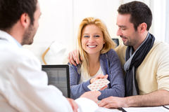 Doctor gives pills to couple of patient Royalty Free Stock Image