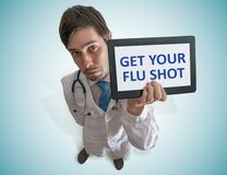 Doctor is giving advice to get your flu shot. View from top Royalty Free Stock Photos