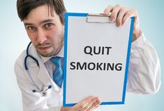 Doctor is giving advice to quit smoking. View from top Stock Photos