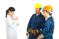 Doctor giving advices to workers men Stock Images