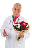 Doctor is giving apologies. Doctor is giving flowers to say I am wrong stock image