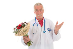 Doctor is giving apologies. Doctor is giving flowers to say I am wrong stock photography