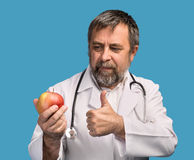 Doctor giving apple for healthy eating Stock Images