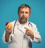 Doctor giving apple for healthy eating Stock Photo