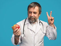 Doctor giving apple for healthy eating Royalty Free Stock Image