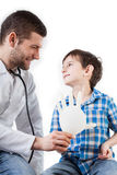 Doctor giving a balloon to a kid Stock Photos