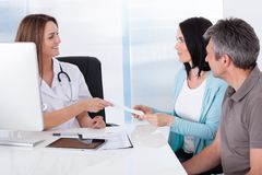 Doctor giving card to patient Stock Photography