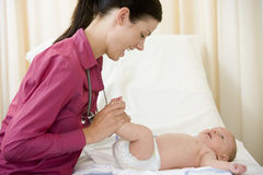 Doctor giving checkup to baby in exam room Royalty Free Stock Photography