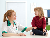 Doctor giving checkup to young girl Stock Photo