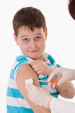 Doctor giving a child injection in arm. On  image Royalty Free Stock Image