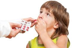 Doctor giving child medication Stock Photos