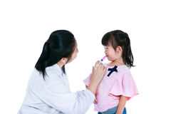 Doctor giving child medication by syringe. Isolated on white bac Royalty Free Stock Images