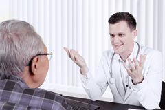 Doctor giving a consultation to elderly patient Stock Photo