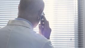 Doctor giving a consultation to a patient on the phone