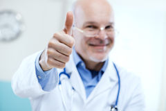 Doctor giving good news Stock Images