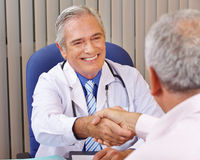 Doctor giving handshake to patient Royalty Free Stock Images