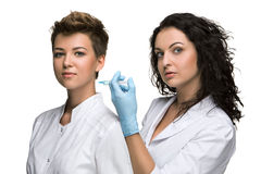 Doctor giving an injection to female patient Royalty Free Stock Photo