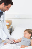 Doctor giving injection to ill girl Royalty Free Stock Image