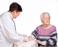 Doctor giving injection to old woman Royalty Free Stock Photo