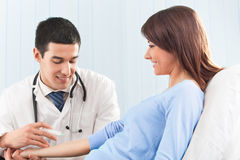 Doctor giving an injection to patient Stock Image