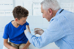 Doctor giving an injection to the patient Royalty Free Stock Photo