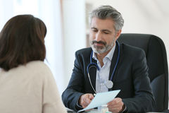 Doctor giving medical prescription to patient Stock Photos