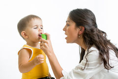 Doctor giving medical spray  to kid Royalty Free Stock Image