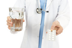 Doctor giving medicine with a glass of water Royalty Free Stock Photo
