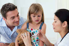 Doctor giving medicine to a little girl Royalty Free Stock Image