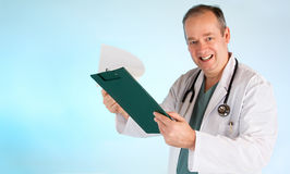 Doctor Giving Out Medical Test Result. A smiling doctor is giving medical test result to his patient royalty free stock photo