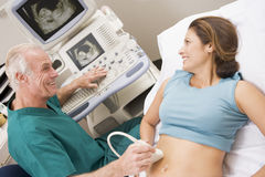 Doctor Giving Patient An Ultra Sound Royalty Free Stock Photography