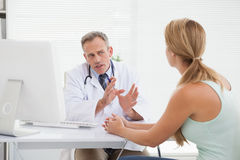 Doctor giving patients their test results Stock Photos